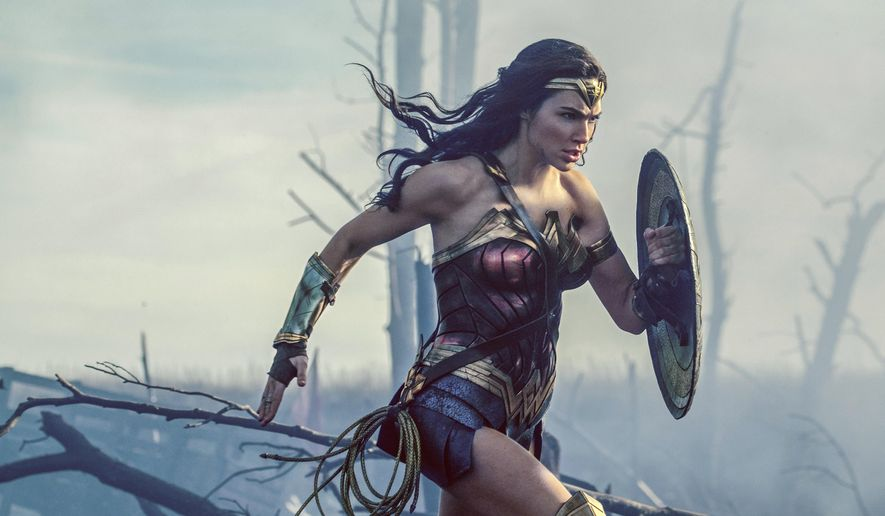 "This image released by Warner Bros. Entertainment shows Gal Gadot in a scene from ""Wonder Woman.""  The Patty Jenkins-directed blockbuster received zero Oscar nominations Tuesday, Jan. 23, 2018, even in a year that was surprisingly friendly to big budget hits. (Clay Enos/Warner Bros. Entertainment via AP)"