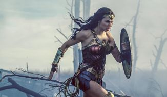"""This image released by Warner Bros. Entertainment shows Gal Gadot in a scene from """"Wonder Woman.""""  The Patty Jenkins-directed blockbuster received zero Oscar nominations Tuesday, Jan. 23, 2018, even in a year that was surprisingly friendly to big budget hits. (Clay Enos/Warner Bros. Entertainment via AP)"""