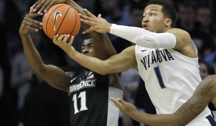 Villanova guard Jalen Brunson (1) and Providence guard Alpha Diallo (11) fight for a rebound in the first half of an NCAA college basketball game, Tuesday, Jan. 23, 2018, in Philadelphia. (AP Photo/Laurence Kesterson)