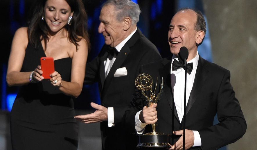 """FILE - This is a Sunday, Sept. 20, 2015  file photo of Armando Iannucci, right, as he receives the award for outstanding comedy series  """"Veep""""  from  Julia Louis-Dreyfus, Mel Brooks at the 67th Primetime Emmy Awards at the Microsoft Theater in Los Angeles. Russia's Culture Ministry on Tuesday Jan. 23, 2017   banned Armando Iannucci's satirical film about Soviet dictator Josef Stalin's death two days before its scheduled release.   (Photo by Chris Pizzello/Invision, File AP)"""