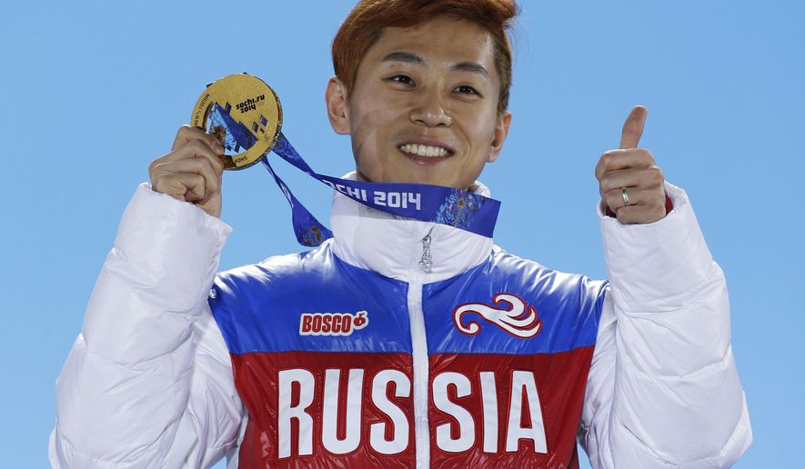 FILE - In this Feb. 15, 2014, file photo, men's 1,000-meter short track speedskating gold medalist Viktor Ahn, of Russia, gestures while holding his medal during the medals ceremony at the Winter Olympics in Sochi, Russia. The Russian Olympic Committee says Ahn, a six-time Olympic gold medalist, is among several top Russian athletes barred from the upcoming Pyeongchang Olympics amid the country's ongoing doping scandal. (AP Photo/David J. Phillip, File)