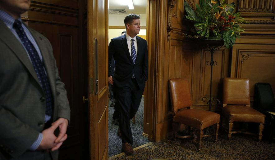 Supervisor Mark Farrell walks back into the meeting at City Hall after being voted interim mayor by the board of supervisors, Tuesday, Jan. 23, 2018, in San Francisco. (Santiago Mejia/San Francisco Chronicle via AP)