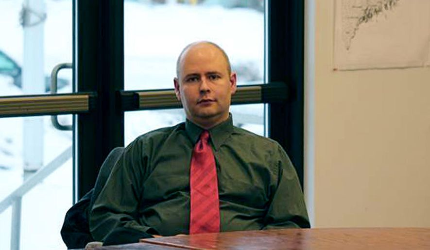Town Manager Tom Kawczynski sits in the Jackman, Maine, town hall on Tuesday, Jan. 23, 2018, before a select board meeting over his publicly espoused white separatist views. The Jackman Select Board voted unanimously to dismiss him, announcing the decision after a closed-door executive session with Kawczynski, who had been the town's top administrator since June. (Jake Bleiberg/The Bangor Daily News via AP)