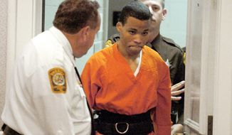 FILE - In this Oct. 26, 2004, file photo, Lee Boyd Malvo enters a courtroom in the Spotsylvania, Va., Circuit Court. A federal appeals court is set to hear arguments Tuesday, Jan. 22, 2018, in a case focusing on the life sentences given to D.C. sniper Malvo. A federal judge in Virginia found that Malvo is entitled to new sentencing hearings in light of a U.S. Supreme Court ruling that mandatory life sentences for juveniles are unconstitutional. Malvo was 17 when he was arrested in a series of random shootings that killed 10 people and wounded three in Virginia, Maryland and the District of Columbia in 2002. (Mike Morones/The Free Lance-Star via AP)