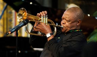 FILE - In this March 2012 file photo, South African jazz musician Hugh Masekela performs during the Observance for Commonwealth Day service at Westminster Abbey in central London. A family statement issued on Twitter Tuesday Jan. 23, 2018, says South African jazz musician and anti-apartheid activist Hugh Masekela, 78, passed away in Johannesburg after a lengthy battle against prostate cancer. (Leon Neal/Pool Photo via AP, File)