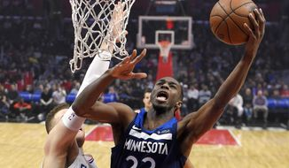Minnesota Timberwolves forward Andrew Wiggins, right, shoots as Los Angeles Clippers forward Blake Griffin defends during the first half of an NBA basketball game, Monday, Jan. 22, 2018, in Los Angeles. (AP Photo/Mark J. Terrill)
