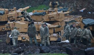 Turkish soldiers prepare their tanks to enter combat and join a military offensive on a Kurdish-held enclave in northern Syria, at a staging area in the Hatay province,Turkey near the the border with Syria.Turkey launched an operation, codenamed Olive Branch, last week against the Syrian Kurdish People's Protection Units in Afrin, Syria that it deems a terror group. The operation codenamed Olive Branch is on its fourth day. (AP Photo/Lefteris Pitarakis)