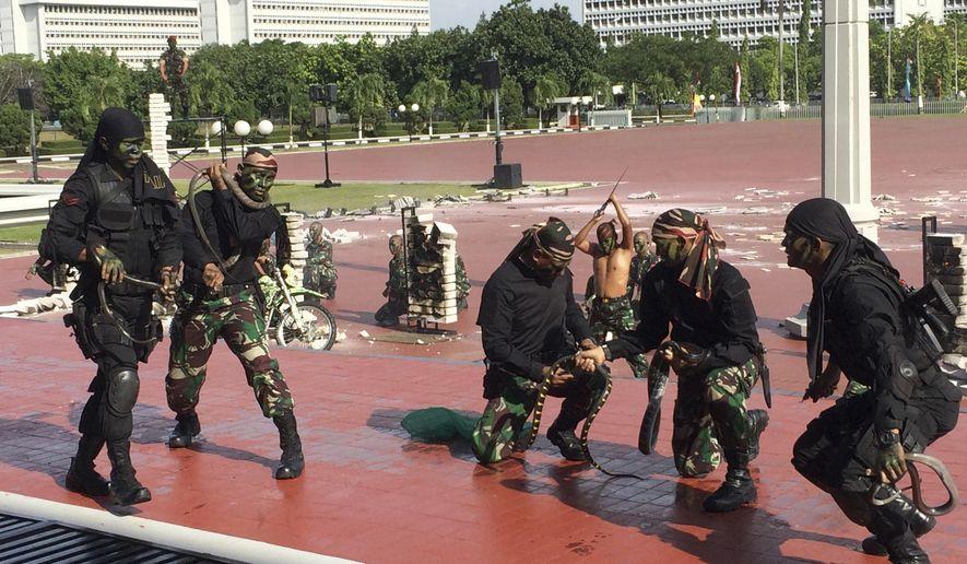 Indonesian special forces demonstrate snake-handling Wednesday, Jan. 24, 2018, for U.S. Defense Secretary Jim Mattis in Jakarta, Indonesia. (AP Photo/Robert Burns)