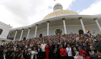FILE - In this Aug. 4, 2017 file photo, Venezuela's Constitutional Assembly poses for an official photo after being sworn in, at the National Assembly in Caracas, Venezuela. On Jan. 23, 2018, the assembly ordered presidential elections by April 30. (AP Photo/Ariana Cubillos, File)