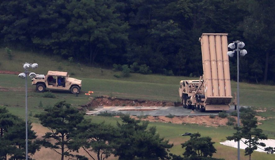 In a major review of the Pentagon, a top official called for buying more current systems, including the Terminal High Altitude Area Defense, or THAAD, like the one seen here at a golf course in South Korea. (Associated Press)