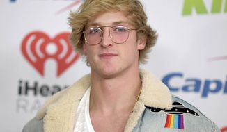"""FILE - In this Dec. 1, 2017 file photo, YouTube personality Logan Paul arrives at Jingle Ball in Inglewood, Calif. Paul has returned to YouTube with a 7-minute suicide prevention video he hopes will """"make a difference in the world."""" He was suspended by YouTube after posting video of him in a forest in Japan near what seemed to be a body hanging from a tree. The location is known in Japan as a frequent site for suicides. (Photo by Richard Shotwell/Invision/AP, File)"""