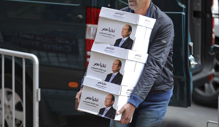Egyptian President Abdel-Fattah el-Sissi's image is emblazoned on boxes containing petitions from voters who want him to run again. Mr. el-Sissi submitted his nomination documents to Egypt's election commission on Wednesday, a day after a potentially serious challenger was arrested over criminal allegations, including forgery and incitement against the country's military. (Egyptian President's Facebook page via Associated Press)