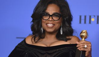 """FILE - In this Jan. 7, 2018, file photo, Oprah Winfrey poses in the press room with the Cecil B. DeMille Award at the 75th annual Golden Globe Awards in Beverly Hills, Calif. Winfrey has visited the grave of a black Alabama woman whose rape by six white men in 1944 drew national attention and whose story was highlighted in Winfrey's recent Golden Globes speech. Winfrey said in an Instagram post that on assignment for """"60 Minutes,"""" she ended up in the town of Abbeville, Ala., where Recy Taylor suffered injustice, endured and recently died. (Photo by Jordan Strauss/Invision/AP, File)"""