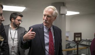 Sen. Angus King, I-Maine, and other senators arrive to vote on the confirmation of Samuel Brownback, governor of Kansas and a former U.S. senator, to become the ambassador-at-large for international religious freedom, at the Capitol in Washington, Wednesday, Jan. 24, 2018. (AP Photo/J. Scott Applewhite) ** FILE **