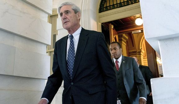 In this June 21, 2017, photo, former FBI Director Robert Mueller, the special counsel probing Russian interference in the 2016 election, departs Capitol Hill following a closed-door meeting in Washington. (AP Photo/Andrew Harnik, File)