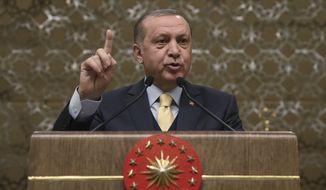 "Turkey's President Recep Tayyip Erdogan told local administrators in Ankara on Wednesday that the military's incursion into a Kurdish-held enclave in Syria was progressing ""successfully"" and would continue until the last ""terrorist"" is eliminated. (Associated Press/File)"