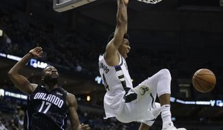 FILE - In this Jan. 10, 2018, file photo, Milwaukee Bucks' Giannis Antetokounmpo dunks in front of Orlando Magic's Jonathon Simmons during the second half of an NBA basketball game in Milwaukee. AP basketball writer Brian Mahoney would take Antetokounmpo in the first round of the All-Star Game draft. (AP Photo/Morry Gash, File)