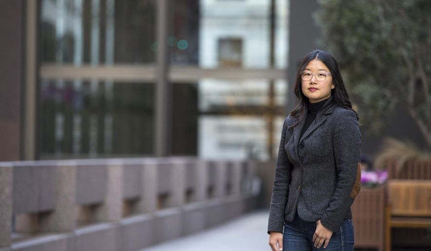 In this Dec. 7, 2017, photo provided by Drew Bird Photography, Jaeah Lee poses for a photo in San Francisco. Lee is one of two freelance journalists who have won the first American Mosaic Journalism Prize for reports on the struggles of U.S. immigrants and others, which was announced Wednesday, Jan. 24, 2018. The prize was created by the Heising-Simons Foundation, a family-run charity in Silicon Valley, for reporting on groups the founders say are underrepresented or misrepresented. (Drew Bird Photography via AP)