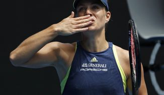 Germany's Angelique Kerber blows the kisses to the crowd after defeating United States' Madison Keys in their quarterfinal at the Australian Open tennis championships in Melbourne, Australia, Wednesday, Jan. 24, 2018. (AP Photo/Ng Han Guan)