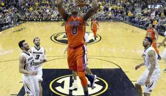 Auburn's Horace Spencer (0) dunks during the second half of the team's NCAA college basketball game against Missouri on Wednesday, Jan. 24, 2018, in Columbia, Mo. Auburn won 91-73. (AP Photo/Jeff Roberson)