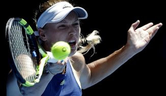 Denmark's Caroline Wozniacki hits a forehand return to Belgium's Elise Mertens during their semifinal at the Australian Open tennis championships in Melbourne, Australia, Thursday, Jan. 25, 2018. (AP Photo/Dita Alangkara)