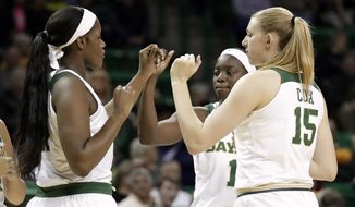 In this Saturday, Jan. 20, 2018 photo, Baylor center Kalani Brown (21), forward Lauren Cox (15) and Dekeiya Cohen (1) greet each other on the court at the start of an NCAA college basketball game against Kansas State in Waco, Texas. (AP Photo/Tony Gutierrez)