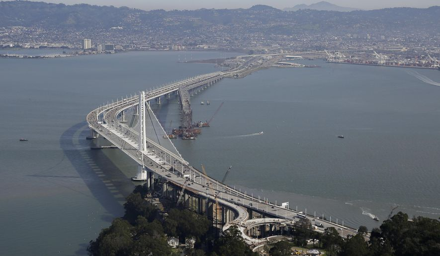 FILE - In this Feb. 5, 2016, file photo, the eastern section of the San Francisco-Oakland Bay Bridge is seen in San Francisco. It could cost $9 to cross the Oakland-San Francisco Bay Bridge if the region's voters approve toll increases to pay for transportation improvements in the notoriously gridlocked region. (AP Photo/Eric Risberg, file)
