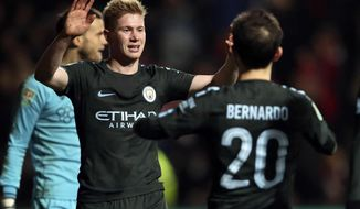 Manchester City's Kevin De Bruyne, left, celebrates scoring his side's third goal of the game during the English League Cup semi final, second leg match against Bristol City at Ashton Gate, Bristol, England, Tuesday, Jan. 23, 2018. (Nick Potts/PA via AP)