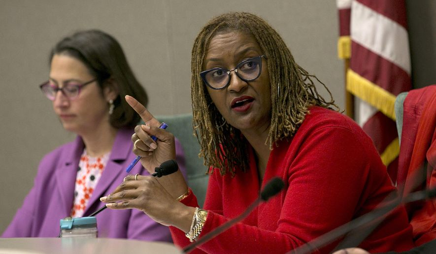 State Sen. Holly Mitchell, D-Los Angeles, right, vice chairwoman of a joint legislative committee on sexual harassment prevention and response, discusses the committees objectives Wednesday, Jan. 24, 2018, in Sacramento, Calif. Lawmakers from both houses joined together to start the process to reform the Legislature's policies for handling sexual harassment allegations. (AP Photo/Rich Pedroncelli)