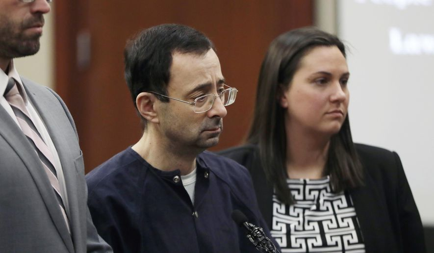 "Larry Nassar walks to the podium with attorneys Matt Newburg, left, and, Shannon Smith during his sentencing hearing Wednesday, Jan. 24, 2018, in Lansing, Mich.  The former sports doctor who admitted molesting some of the nation's top gymnasts for years was sentenced Wednesday to 40 to 175 years in prison as the judge declared: ""I just signed your death warrant.""  The sentence capped a remarkable seven-day hearing in which scores of Nassar's victims were able to confront him face to face in the Michigan courtroom.  (AP Photo/Carlos Osorio)"