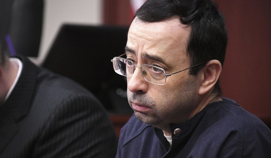 Larry Nassar looks at the gallery in the court during the sixth day of his sentencing hearing Tuesday, Jan. 23, 2018, in Lansing, Mich. Nassar has admitted sexually assaulting athletes when he was employed by Michigan State University and USA Gymnastics, which is the sport's national governing organization and trains Olympians. (Dale G.Young/Detroit News via AP)
