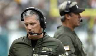 FILE - In this Nov. 5, 2017, file photo, Philadelphia Eagles' Jim Schwartz watches from the sideline during the first half of an NFL football game against the Denver Broncos in Philadelphia. Schwartz doesn't appear to be getting a head coaching job but perhaps deserves one after the way he's rebuilt an awful defense in two years. The Eagles ranked among the bottom three for three straight years under Chip Kelly and rose to the top five under Schwartz.(AP Photo/Michael Perez, File) **FILE**