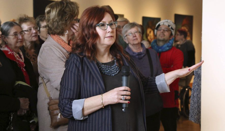 In a Jan. 20, 2018 photo, Mary Solberg talks about her water portraits during a presentation at the Minnesota Marine Art Museum in Winona, Minn.  (Andrew Thoreson/The Winona Daily News via AP)