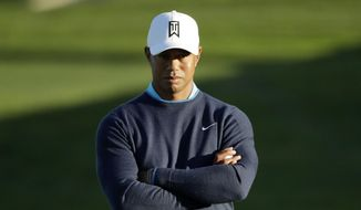 Tiger Woods waits to hit on the fifth hole of the north course at Torrey Pines Golf Course dduring the pro-am event at the Farmers Insurance Open golf tournament, Wednesday, Jan. 24, 2018, in San Diego. (AP Photo/Gregory Bull)