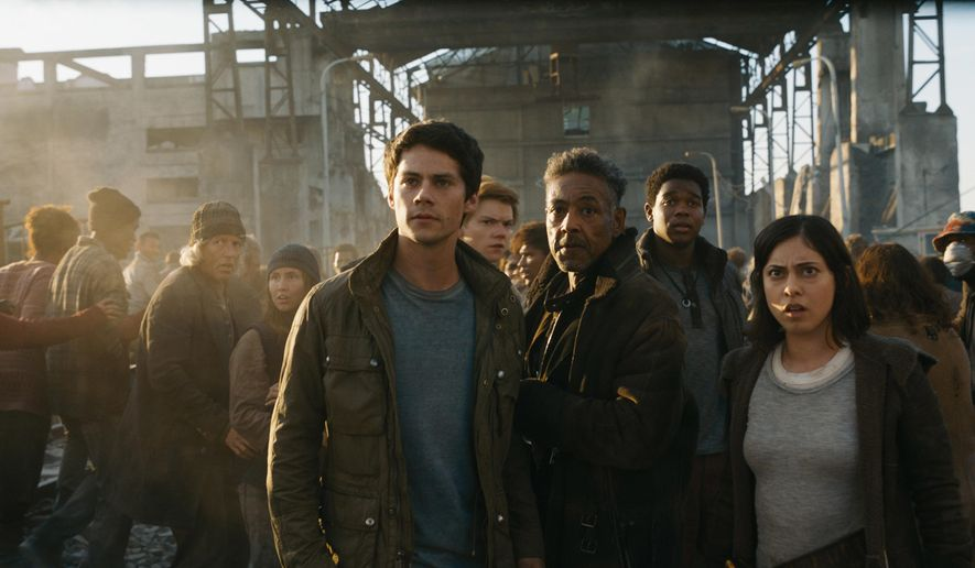 "This image released by Twentieth Century Fox shows, foreground from left, Dylan O'Brien, Giancarlo Esposito and Rosa Salazar in a scene from ""Maze Runner: The Death Cure."" (Twentieth Century Fox via AP)"