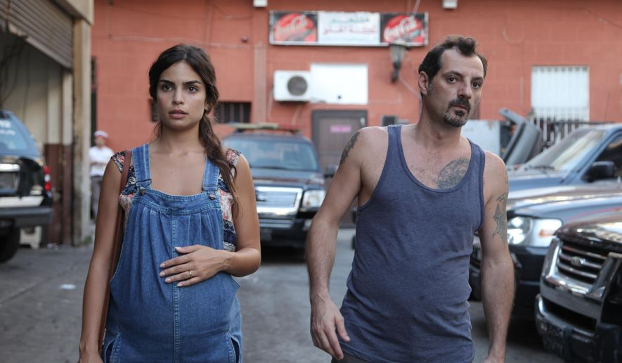 "This image released by Cohen Media Group shows Rita Hayek, left, and Adel Karam in a scene from ""The Insult."" (Cohen media Group via AP)"