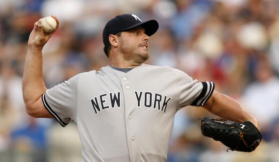 FILE - In this July 23, 2007, file photo, New York Yankees starting pitcher Roger Clemens throws to a Kansas City Royals batter during the first inning of a baseball game in Kansas City, Mo. Clemens and Barry Bonds fell short in elections to the baseball Hall of Fame. (AP Photo/Ed Zurga, File)
