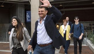 Former San Diego Padres closer Trevor Hoffman waves to fans as he walks to a news conference Wednesday, Jan. 24, 2018, in San Diego after he was elected to the baseball Hall of Fame. (AP Photo/Kyusung Gong)