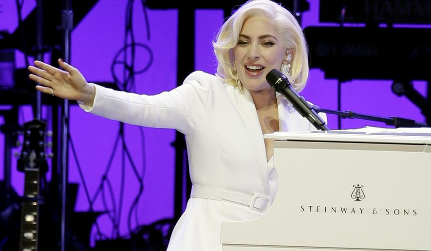 FILE - In this Oct. 21, 2017, file photo, Lady Gaga performs during a hurricanes relief concert in College Station, Texas. A statement Wednesday, Jan. 24, 2018, says the relief effort raised more than $41 million, benefitting hurricane recovery in Texas, Florida, Puerto Rico and the U.S. Virgin Islands. (AP Photo/LM Otero, File)