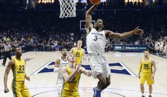 Xavier's Quentin Goodin (3) dunks in the first half of an NCAA college basketball game against Marquette, Wednesday, Jan. 24, 2018, in Cincinnati. (AP Photo/John Minchillo)