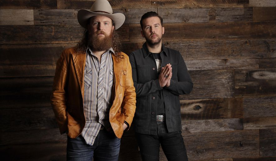 In this Jan. 9, 2018, photo, John, left, and T. J. Osborne, of the group Brothers Osborne, pose in Nashville, Tenn. Since releasing their debut album in 2016, the Maryland-born brothers TJ and John Osborne have been racking up the country music awards and high profile appearances, including the 60th annual Grammy Awards this Sunday. (AP Photo/Mark Humphrey)