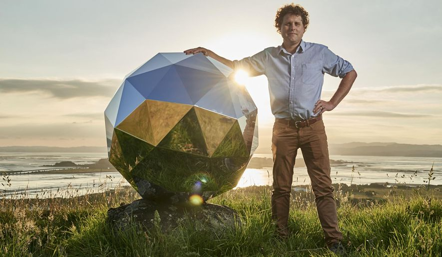 """In this Nov. 2017 photo provided by Rocket Lab, Rocket Lab founder and CEO Peter Beck is pictured with his """"Humanity Star"""" in Auckland, New Zealand. Beck, the founder of the company that this week launched the first rocket into orbit from New Zealand said on Wednesday, Jan 24, 2018, that he had deployed a secret satellite he believes will be the brightest object in the night sky and which he hopes will remind people of their precarious place in a vast universe. (Rocket Lab via AP)"""