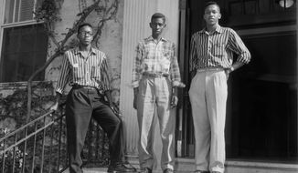 FILE- This September 1955 file photo provided by the Roland Giduz Photographic Collection/The Wilson Library at UNC Chapel Hill, shows from left, LeRoy Frasier, John Lewis Brandon and Ralph Frasier on the steps of the University of North Carolina at Chapel Hill, N.C. Brandon, who along with brothers Ralph and LeRoy Frasier was among the first African-American undergraduate students to successfully challenge racial segregation at North Carolina's flagship public university  died Tuesday, Jan. 23, 2018. He was 80. (Roland Giduz Photographic Collection/The Wilson Library, UNC Chapel Hill via AP)