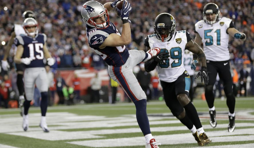 FILE - In this Sunday, Jan. 21, 2018, file photo, New England Patriots wide receiver Danny Amendola (80) catches a touchdown pass in front of Jacksonville Jaguars safety Tashaun Gipson (39) and linebacker Paul Posluszny (51) during the second half of the AFC championship NFL football game in Foxborough, Mass. Amendola has had a knack for producing in big moments in the playoffs the last two seasons. He had a touchdown catch and the tying 2-point conversion during New England's comeback win over Atlanta in last year's Super Bowl. And he was the recipient of two TD passes, including the winner, in its AFC title victory over Jacksonville. (AP Photo/David J. Phillip, File)
