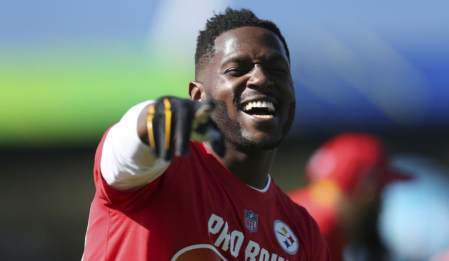 AFC wide receiver Antonio Brown, of the Pittsburgh Steelers, plays around during Pro Bowl NFL football practice, Wednesday, Jan. 24, 2018 in Kissimmee, Fla. (AP Photo/Doug Benc)