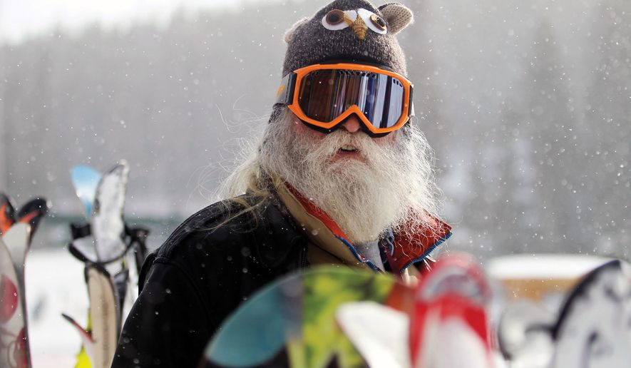 In this photo taken Jan. 12, 2018, Fred Weems stands between the ski racks while preparing to hit the slopes at the Snowy Range Ski Area in Albany County, Wyo. Weems, 65, said he makes it a point to ski as often as possible. (Hannon Broderick/Laramie Boomerang via AP)
