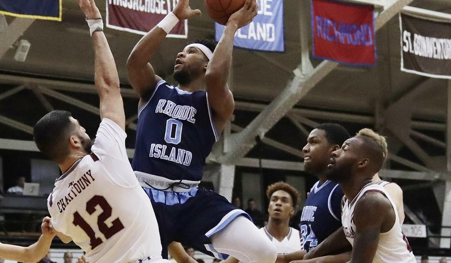 Rhode Island's E.C. Matthews (0) shoots over Fordham's Joseph Chartouny (12) during the first half of an NCAA college basketball game Wednesday, Jan. 24, 2018, in New York. (AP Photo/Frank Franklin II)