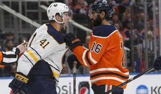 Buffalo Sabres defenseman Justin Falk (41) and Edmonton Oilers left wing Jujhar Khaira (16) have words during the second period of an NHL hockey game Tuesday, Jan. 23, 2018, in Edmonton, Alberta. (Jason Franson/The Canadian Press via AP)
