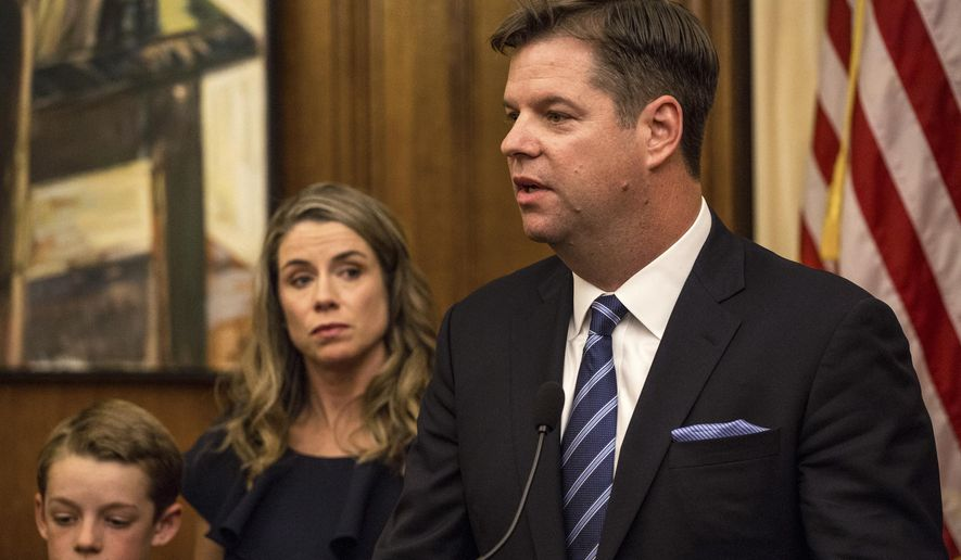 San Francisco Interim Mayor Mark Farrell, joined by family members, speaks to reporters after being sworn into office at City Hall in San Francisco, Tuesday, Jan. 23, 2018. The San Francisco Board of Supervisors on Tuesday appointed Farrell, one of its members, to serve as interim mayor until a new mayor is chosen in a citywide election in June. (AP Photo/Joel Angel Juarez)