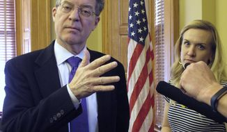 Kansas Gov. Sam Brownback talks to reporters, Wednesday, Jan. 24, 2018, at the Statehouse in Topeka, Kan. The conservative Republican governor had a contentious tenure before President Trump nominated him as U.S. ambassador-at-large for international religious freedom (AP Photo/John Hanna)